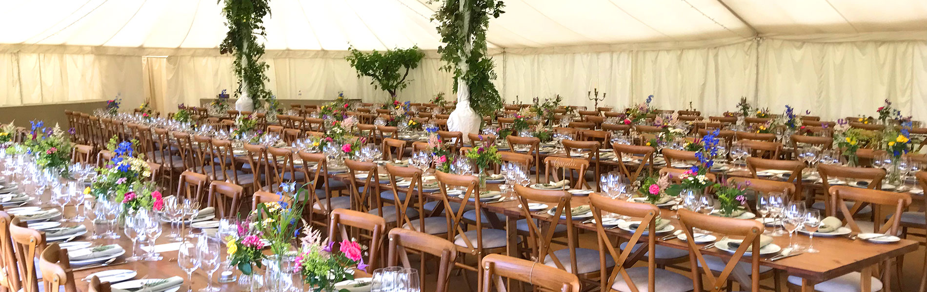 wedding tent with laid tables